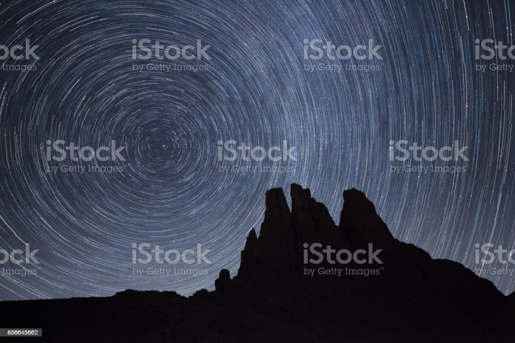 Startrail over the Vajolet towers in Dolomites stock photo