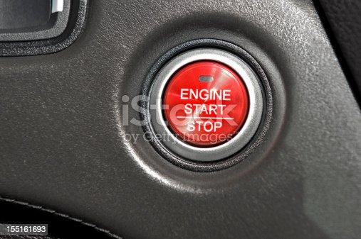 A red push button to start a modern car