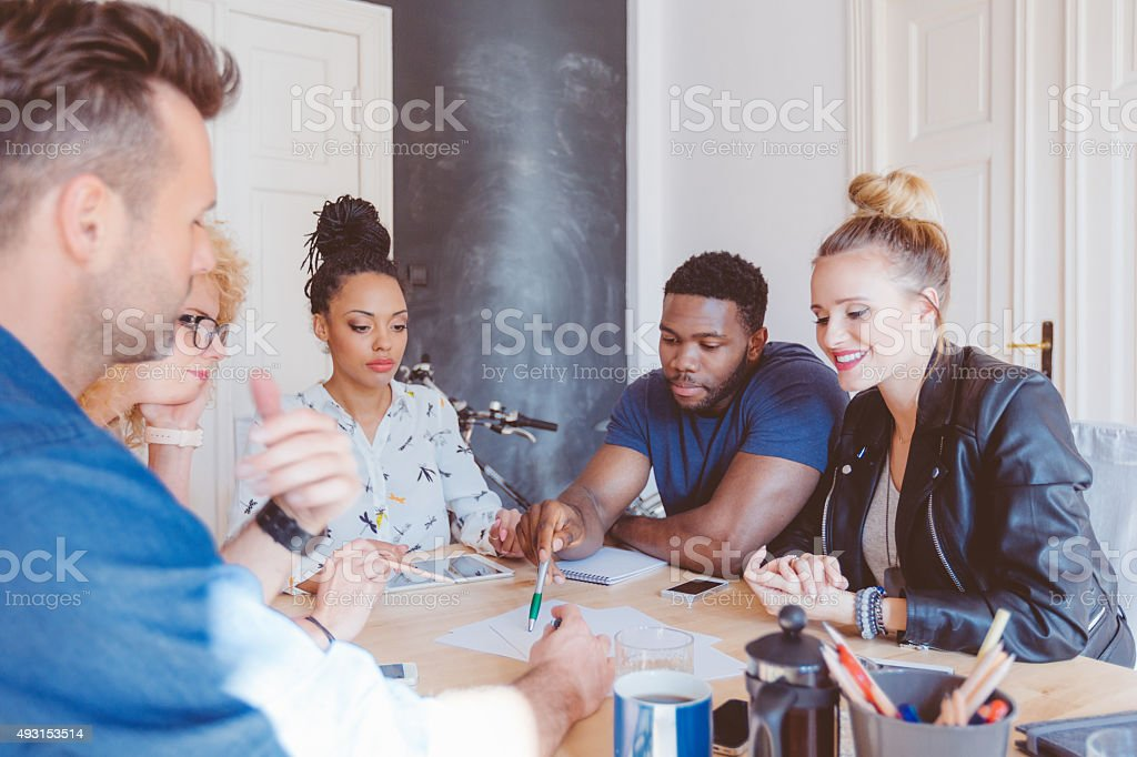 Start-up agency, multi ethnic team brainstorming stock photo