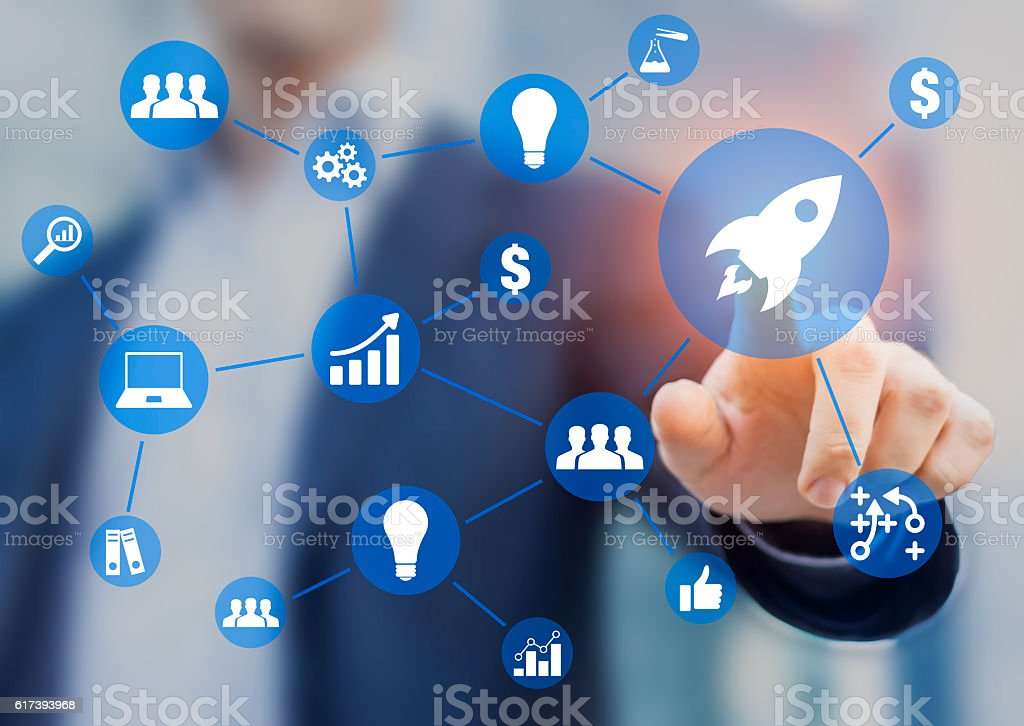 Startup business concept about launching company, businessman touching rocket icon stock photo