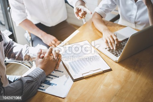 istock Startup business people group meeting, Young creative coworkers team working and discussing new plan project in office, entrepreneurs, brainstorming, Teamwork, professional business team 1042471064