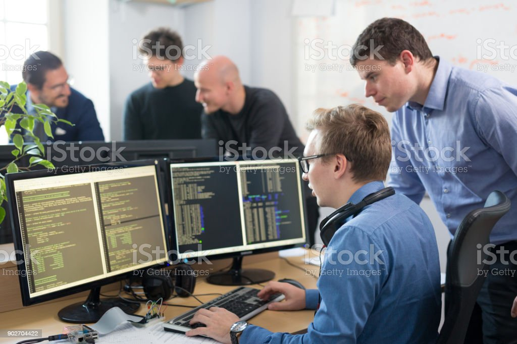 Startup business, software developer working on desktop computer. stock photo