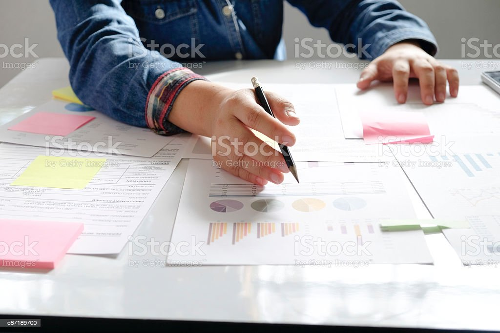 Startup business woman working with business documents on office stock photo