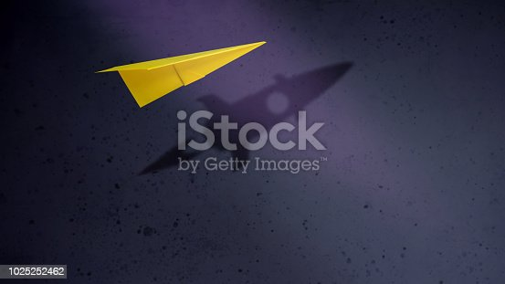 Start-up Company and Motivation in Business Concept. Paper Planes Flying with Shadow of Rocket over the Wall