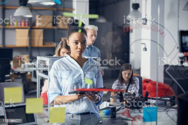Startup company thinking of solution in front of board using tablet picture id1131985221?b=1&k=6&m=1131985221&s=612x612&h=je01y90vgsc8kn8asednd9gju0tkc8kqulbhcvdlab0=