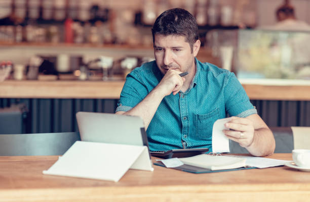 Start-up entrepreneur concerned about financial reports stock photo