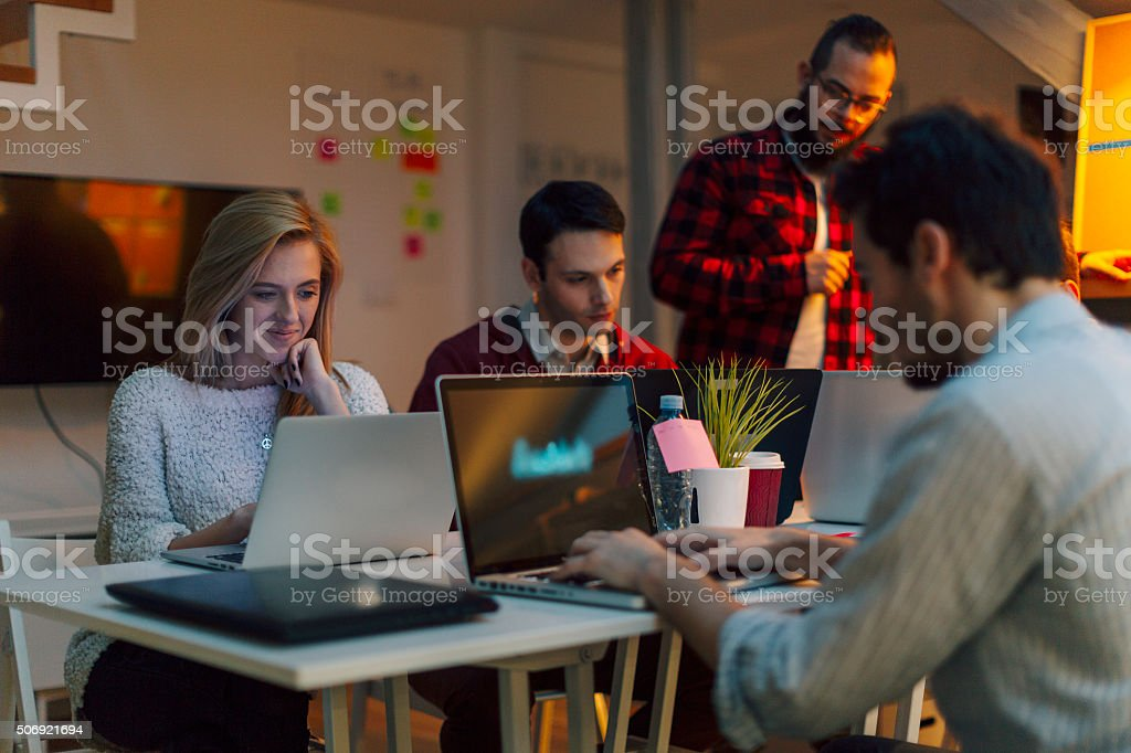 StartUp Programming Team Working Late. stock photo