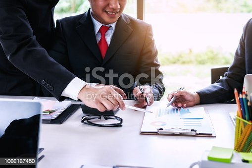 951092116istockphoto Startup project business team with people co-working for analyzing financial data investment in office.Teamwork successful meeting workplace strategy concept. 1066167450