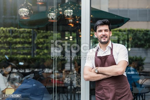 istock Startup successful small business owner man walking in his coffee shop or restaurant. 1171752087