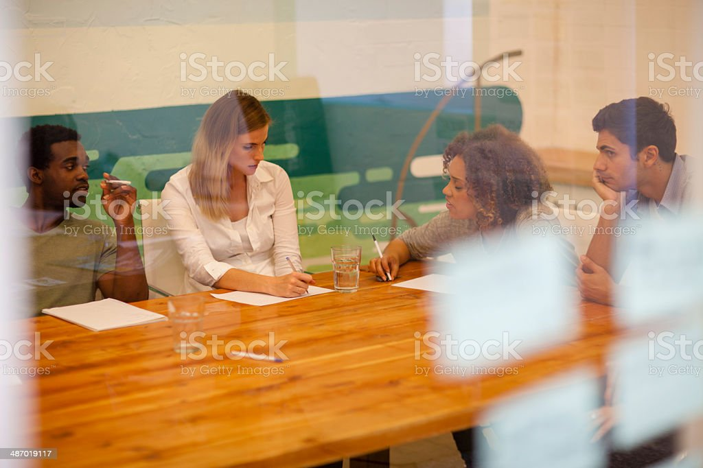 Startup team discussing in their office boardroom stock photo