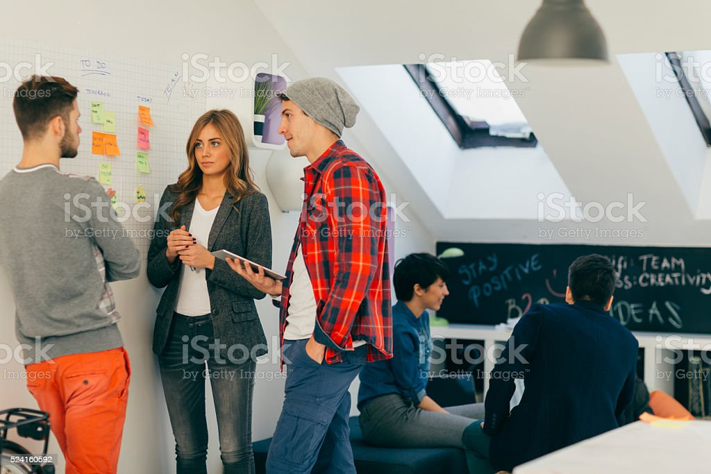 Start-up Team Discussion Near Whiteboard. stock photo