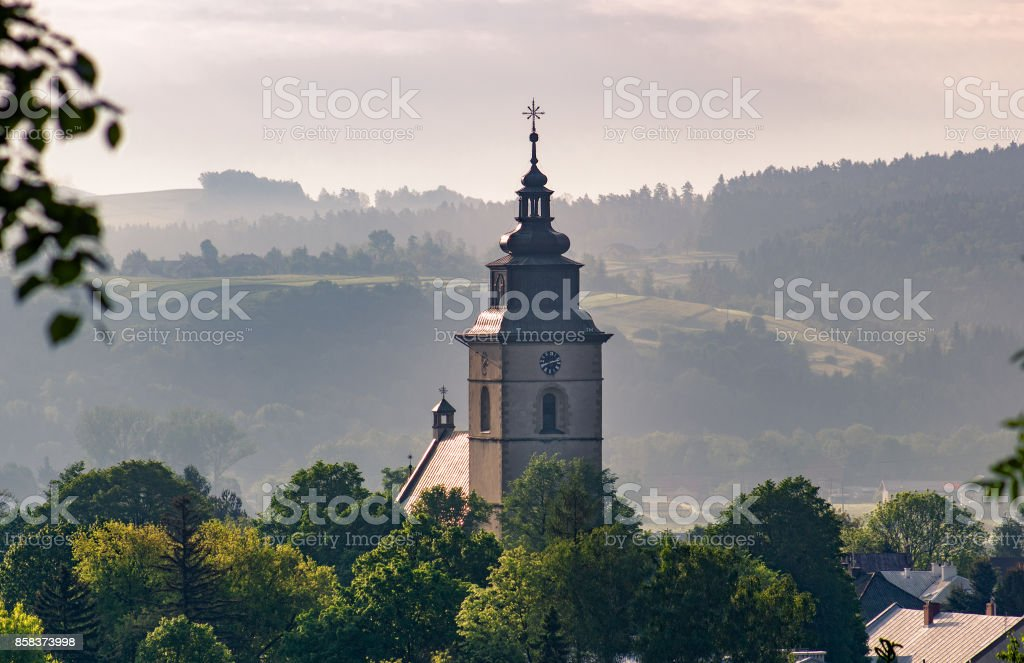 Stary Sacz town at sunrise. Clock tower of Parish Church of St. Elizabeth in the Stary Sacz, Poland. stock photo