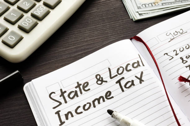 State and local income tax written in a note. stock photo