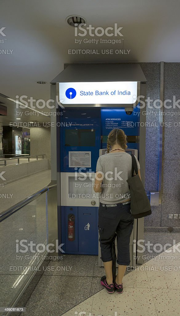 State Bank of India ATM: woman withdrawing money royalty-free stock photo