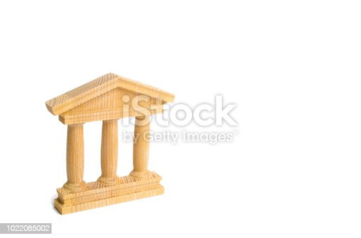 istock State Building. wooden government building Judge's hammer and money, on a white background. concept of state administration and economic institutions. Municipality, government, elections. Bank 1022085002