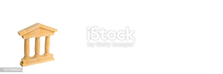 istock State Building. wooden government building Judge's hammer and money, on a white background. concept of state administration and economic institutions. Municipality, government, elections. Bank. Banner 1022085020