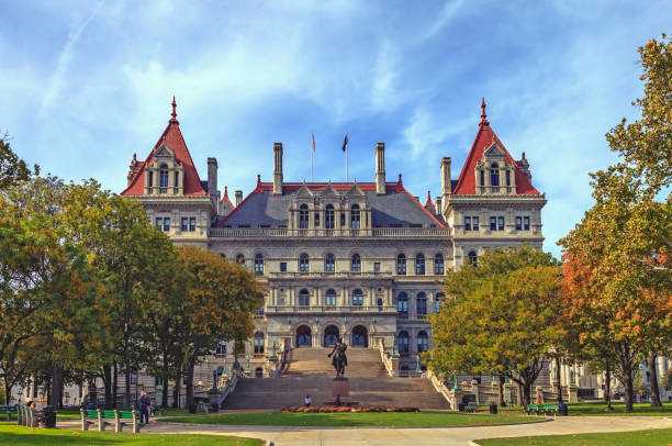NY State Capitol Building in Albany The State Capitol Building in Albany NY is over 125 years old. it is an amazing example of late 19th-century architectural grandeur, but required more than 32 years to complete. Careful restoration continues to maintain the Capitol for future generations. capital cities stock pictures, royalty-free photos & images