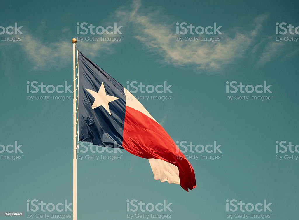 State flag of Texas against blue sky stock photo