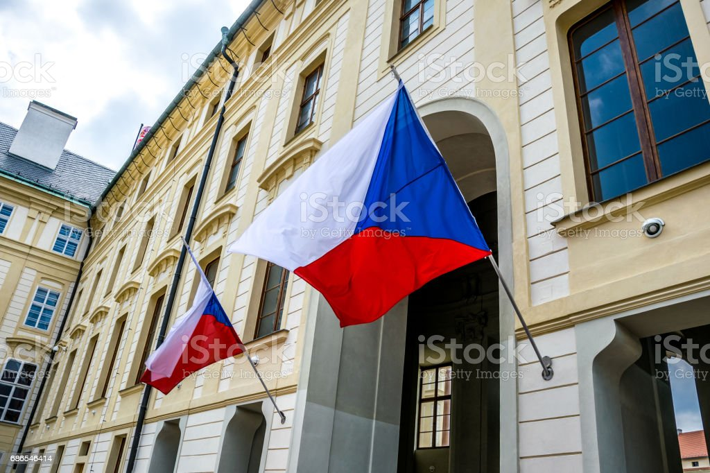 State flags of the Czech Republic at the entrance to the building of the President of the Czech Republic stock photo