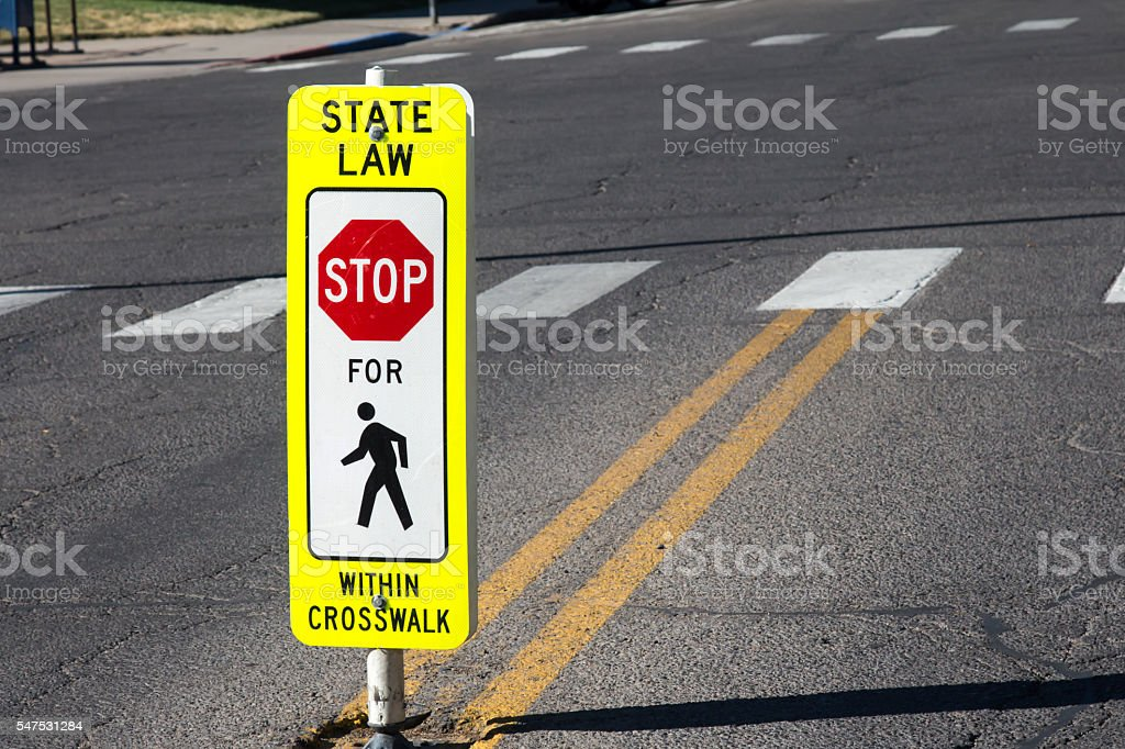 State law Stop for Pedestrians sign stock photo