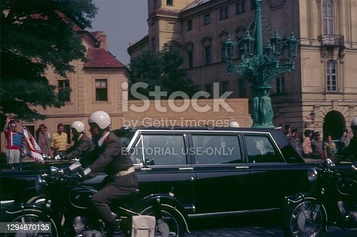 Prague, Czech Republic, 1975. State limousine with a police escort on Prague's Hradcany. So: locals and tourists.