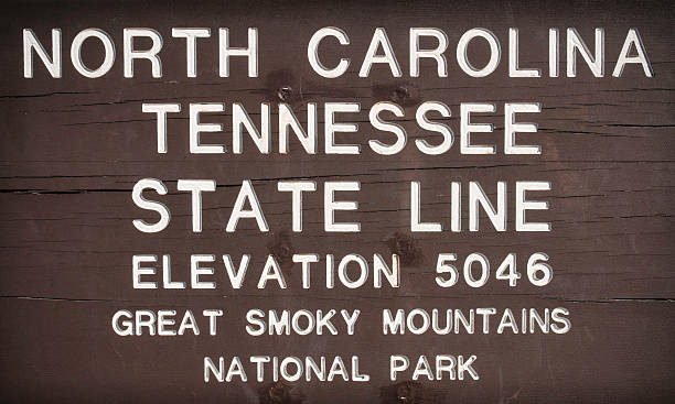 State Line, Newfound Gap, North Carolina, Tennessee, USA Close up view of the timber border sign on the state boundary line between Tennessee and North Carolina at the Newfound Gap in the Great Smoky Mountains National Park.More of my images from the Great Smoky Mountains and Blue Ridge Parkway in this lightbox: north carolina us state stock pictures, royalty-free photos & images