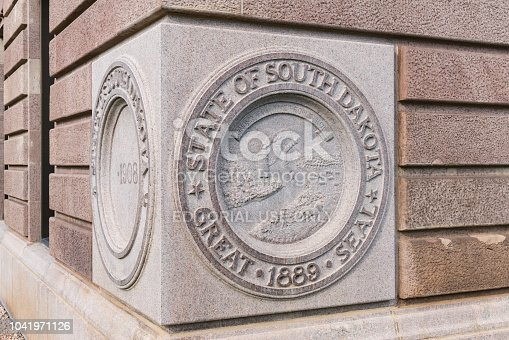 Pierre, SD - July 9, 2018: State Seal of South Dakota on the cornerstone of the Capital Building in Pierre, SD