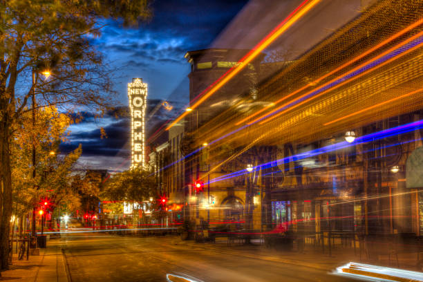 State Street in Madison Wisconsin Madison, Wisconsin, USA - October 16, 2019: Lights from a city bus bring a burst of color to State Street in Madison, Wisconsin. madison wisconsin stock pictures, royalty-free photos & images