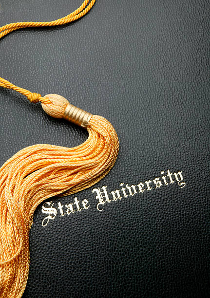 State University Graduation Diploma Cover with Gold TasselTo see more of my education images click on the link below tassel stock pictures, royalty-free photos & images