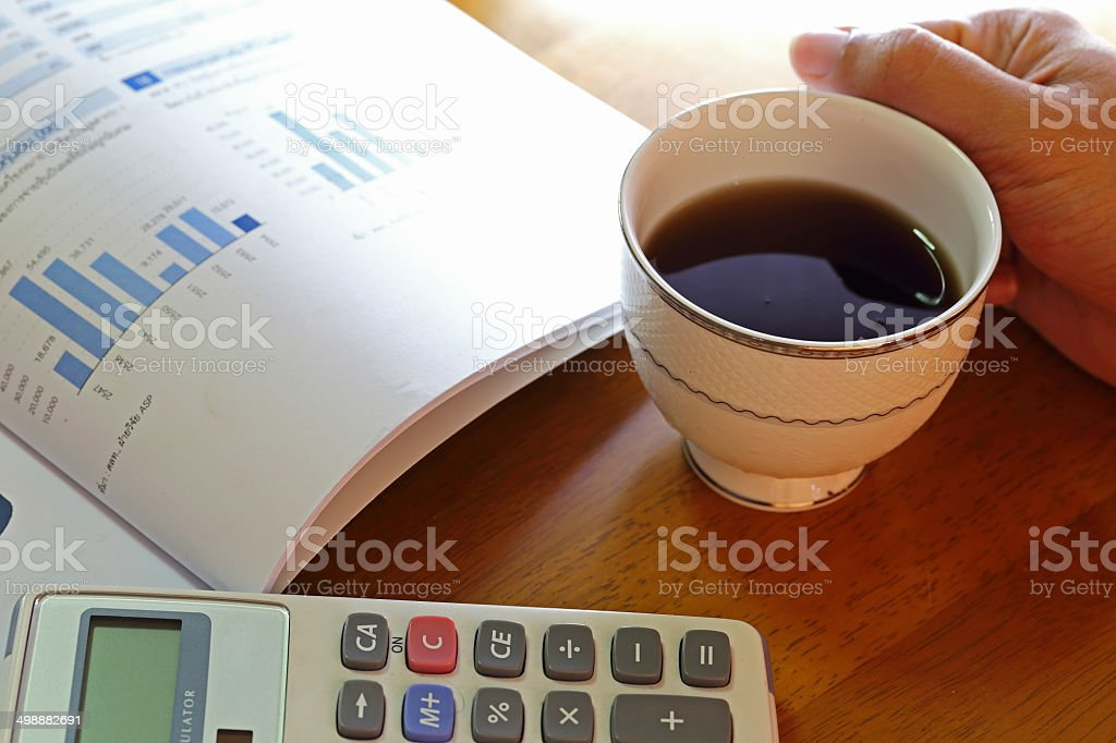 statement with calculator and hand of someone stock photo