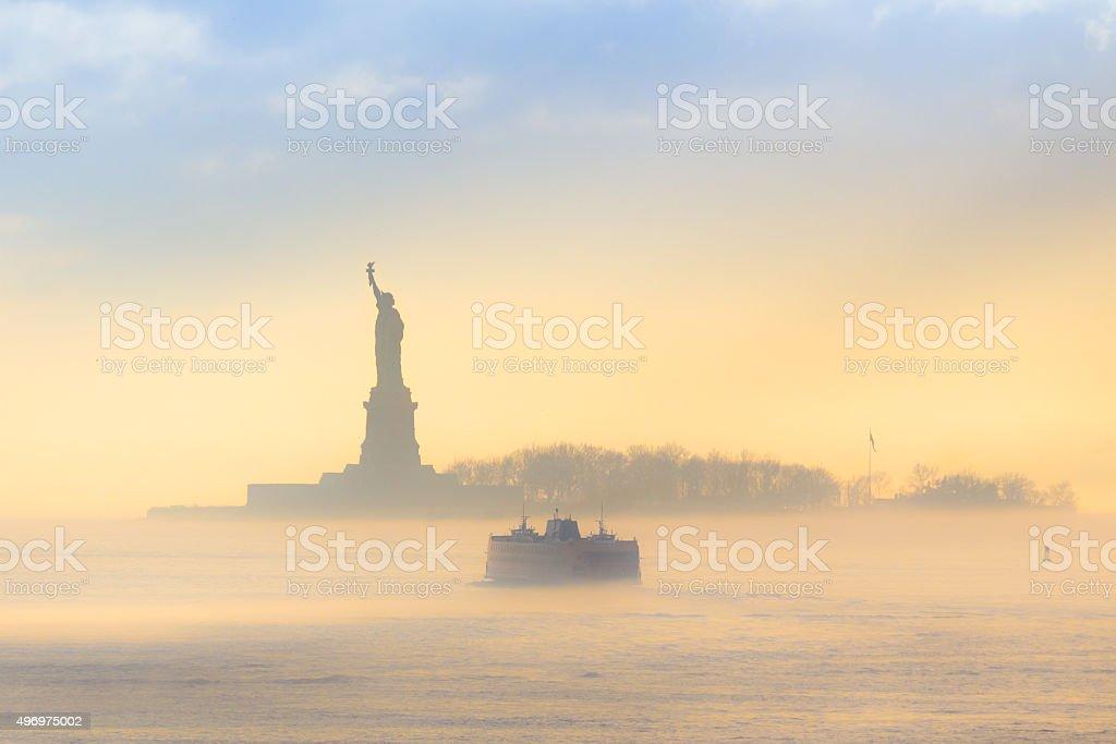 Staten Island Ferry cruises past Statue of Liberty. stock photo