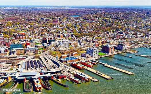 Aerial view of Staten Island St George Ferry terminal. Manhattan Area, New York of USA. Skyline and cityscape with skyscrapers at United States of America, NYC, US. American architecture.