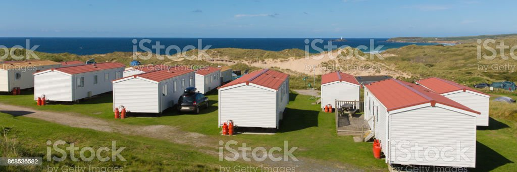 Static caravans with panoramic view to beautiful Cornish coast in summer stock photo