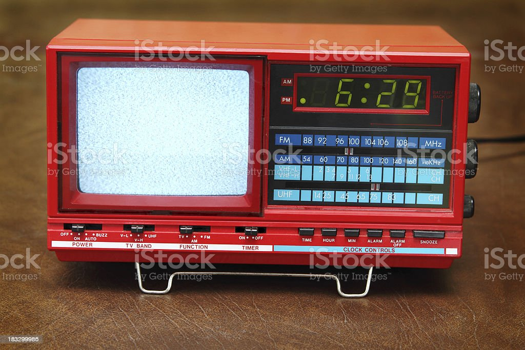 Static fog on vintage analog tv and alarm clock radio stock photo