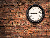 istock Station Clock On A Red Brick Wall 628817402