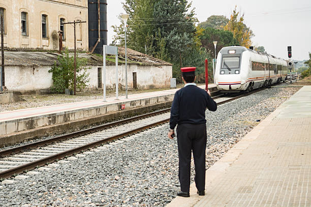 station train with boss controlling railway traffic - transport conductor stock photos and pictures