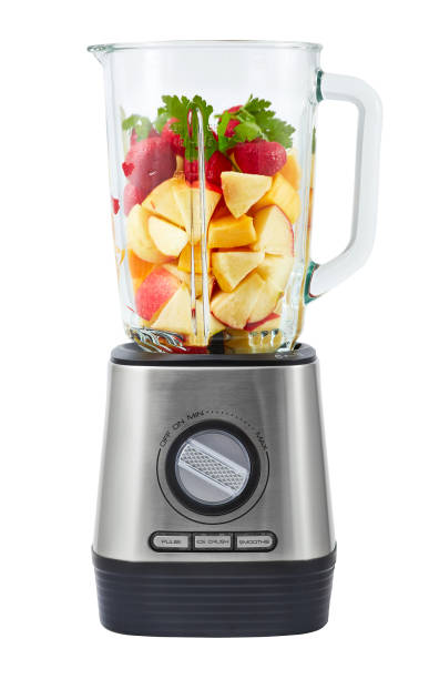 Stationary blender with fruit Stationary blender filled with slices of apples, pumpkins, strawberries for making smoothie. blender stock pictures, royalty-free photos & images