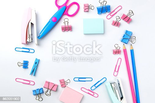 istock Stationary concept, Flat Lay top view Photo of school supplies scissors, pencils, paper clips,calculator,sticky note,stapler and notepad in pastel tone on white background with copy space, flat lay design. 862051902