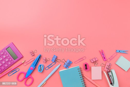 istock Stationary concept, Flat Lay top view Photo of school supplies scissors, pencils, paper clips,calculator,sticky note,stapler and notepad in pastel tone on pink background with copy space, flat lay design. 862051908