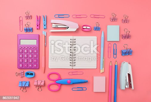 istock Stationary concept, Flat Lay top view Photo of school supplies scissors, pencils, paper clips,calculator,sticky note,stapler and notepad in pastel tone on pink background with copy space, flat lay design. 862051942
