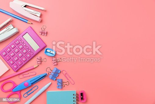 istock Stationary concept, Flat Lay top view Photo of school supplies scissors, pencils, paper clips,calculator,sticky note,stapler and notepad in pastel tone on pink background with copy space, flat lay design. 862051944