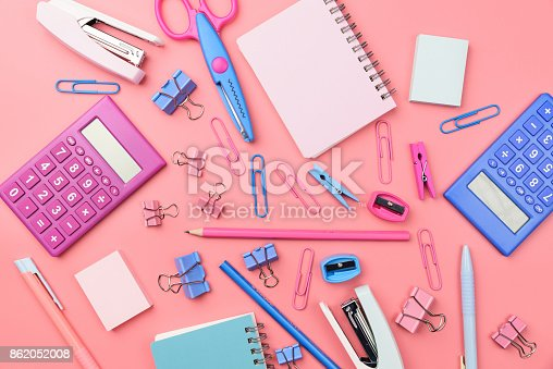 istock Stationary concept, Flat Lay top view Photo of school supplies scissors, pencils, paper clips,calculator,sticky note,stapler and notepad in pastel tone on pink background with copy space, flat lay design. 862052008