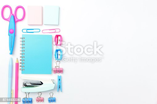 istock Stationary concept, Flat Lay top view Photo of school supplies scissors, pencils, paper clips,calculator,sticky note,stapler and notepad in pastel tone on white background with copy space, flat lay. 874493006