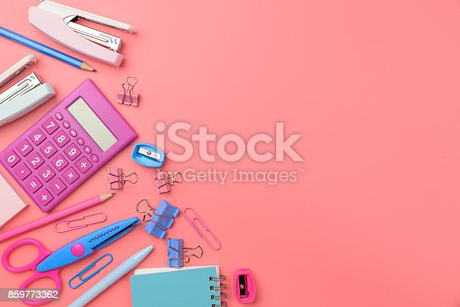 istock Stationary concept, Flat Lay top view Photo of Scissors, pencils, paper clips,calculator,sticky note,stapler and notepad in pink and blue tone on pink background with copy space. 859773362
