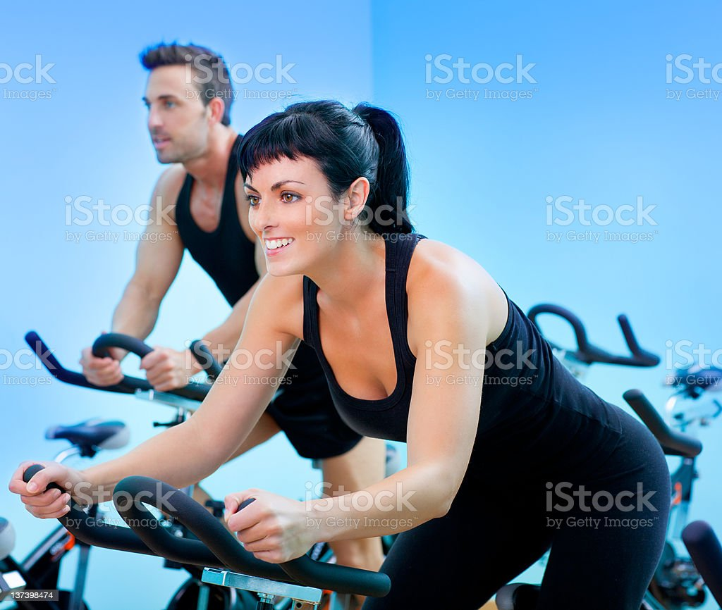 Stationary spinning bicycles fitness girl in a gym royalty-free stock photo