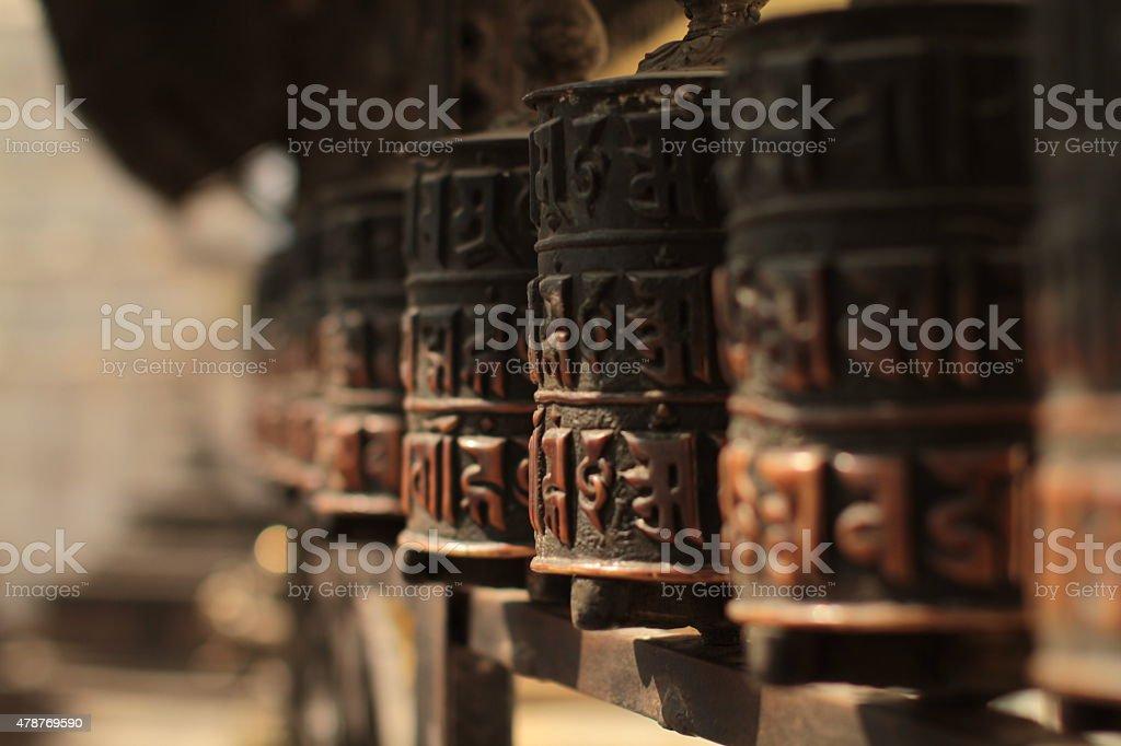 Stationary prayer wheels in Nepal stock photo