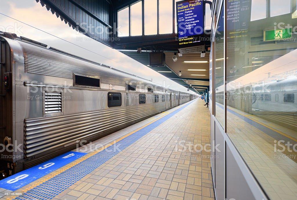 Stationary train at outdoor Sydney central station platform