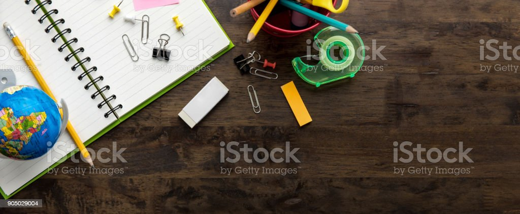Stationery and education supplies on wooden table background, panoramic banner stock photo