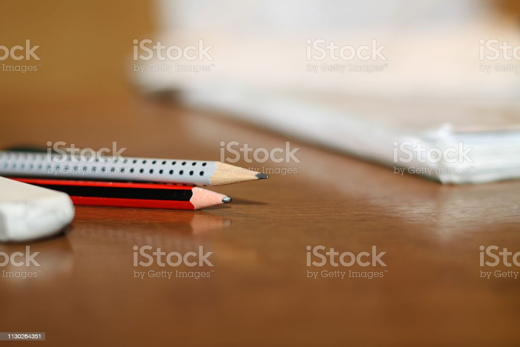 Beautiful stationery pencil and eraser are on the table