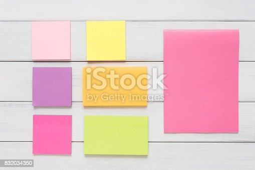 istock Stationery supply - sticky notes paper on wood 832034350